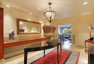 Traditional Entryway with sandstone tile floors, Chandelier, can lights, stone tile floors, Standard height, Wainscotting