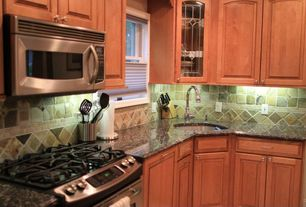 Traditional Kitchen with built-in microwave, Inset cabinets, Limestone Tile, Glass panel, L-shaped, Simple granite counters