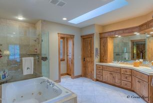 Craftsman Master Bathroom with Double sink, Ceramic Tile, Limestone counters, specialty door, Skylight, Inset cabinets