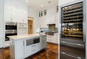 Contemporary Kitchen with Flat panel cabinets, Subzero - full height glass front wine refrigerator, Subway Tile, Custom hood