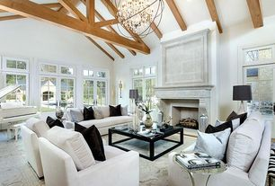 "Cottage Living Room with Restoration hardware foucault's orb crystal chandelier 60"" - rustic iron, Exposed beam, Carpet"