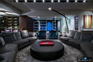 Modern Living Room with Restoration Hardware Belgian Track Arm Upholstered Swivel Chair, Carpet, Built-in bookshelf