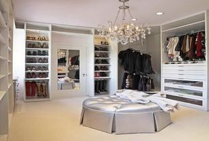 Traditional Closet with Built-in bookshelf, can lights, Glass panel door, Chandelier, Carpet floors, Standard height