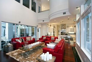Modern Living Room with Hardwood floors, Loft, Cathedral ceiling, picture window, French doors, can lights