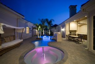 Tropical Hot Tub with Outdoor kitchen, Fence, Fountain, Arched window, exterior brick floors, Pool with hot tub