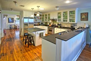 Country Kitchen with Flat panel cabinets, Ceramic Tile, Glass panel, Breakfast bar, Inset cabinets, Kitchen island, U-shaped