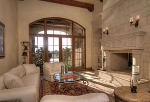Traditional Living Room with Sunken living room, Transom window, French doors, Wall sconce, Cathedral ceiling, Carpet