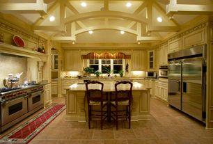 Mediterranean Kitchen with Arizona tile, CAFE CREME, Granite, Undermount sink, Raised panel, U-shaped, slate tile floors
