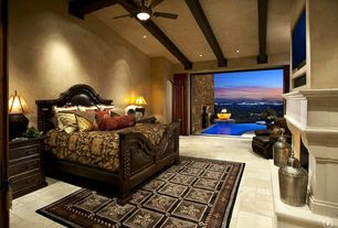 Mediterranean Master Bedroom with Fireplace, High ceiling, Exposed beam, can lights, limestone floors, Cement fireplace