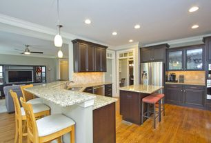 Traditional Kitchen with can lights, full backsplash, Transom window, double wall oven, Breakfast bar, Limestone Tile