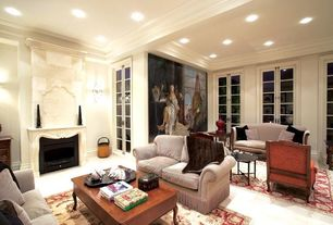 Traditional Living Room with Standard height, French doors, other fireplace, Crown molding, can lights, Built-in bookshelf