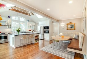 Transitional Kitchen with Skylight, Slate counters, Breakfast bar, Pendant light, High ceiling, Exposed beam, Raised panel