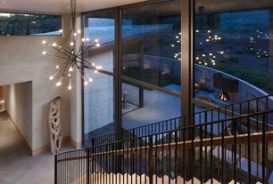 Contemporary Staircase with High ceiling, can lights, specialty window, Chandelier, Floating staircase, Hardwood floors