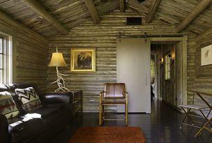 Country Living Room with Vintage Verandah Faux Antler Table Lamp, Laminate floors, flush light, Art desk, High ceiling