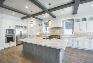 Traditional Kitchen with Exposed beam, Hardwood floors, Louvered door, Flat panel cabinets, Undermount sink, Kitchen island