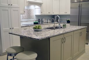 Traditional Kitchen with L-shaped, Custom hood, electric cooktop, Complex granite counters, Undermount sink, Kitchen island