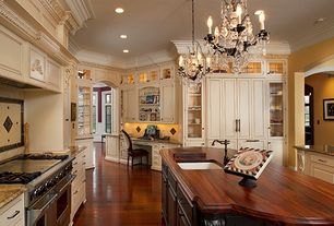 Traditional Kitchen with Pendant light, Undermount sink, Custom Wood Kitchen Countertops, Custom hood, Glass panel, U-shaped