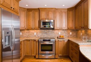 Traditional Kitchen with Simple granite counters, Limestone Tile, MS International Giallo Fantasia Granite, U-shaped