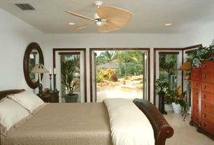 Traditional room with Ceiling fan, can lights, Concrete floors, French doors, picture window, specialty window