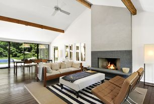 Contemporary Great Room with sliding glass door, Fireplace, picture window, Ceiling fan, Pendant light, Exposed beam