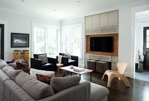 Contemporary Living Room with Hardwood floors, Standard height, can lights, double-hung window, Crown molding