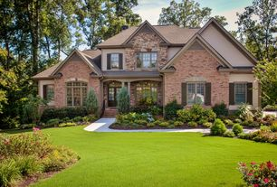 Traditional Exterior of Home with Exterior shutters, Exterior brick siding, Grass