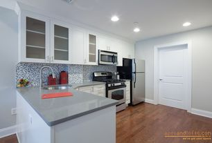 Traditional Kitchen with Undermount sink, L-shaped, Penny Tile, Flush, Hardwood floors, Flat panel cabinets, Glass panel