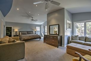 Traditional Master Bedroom with Built-in bookshelf, Carpet, Ceiling fan, French doors