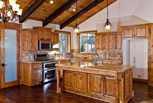 Craftsman Kitchen with Undermount sink, L-shaped, Framed Partial Panel, Stone Tile, Exposed beam, picture window, can lights