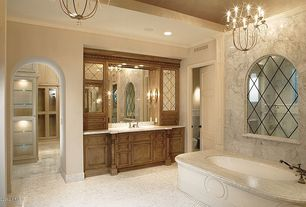 Traditional Master Bathroom with Arched window, Master bathroom, Crown molding, Wall sconce, Undermount sink, Raised panel