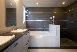 Modern Master Bathroom with Stainless steel tile, Hansgrohe Metris S Electronic Faucet In Chrome, European Cabinets, Flush