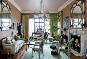 Traditional Living Room with Fireplace, Hardwood floors, Standard height, Crown molding, Wainscotting, Cement fireplace