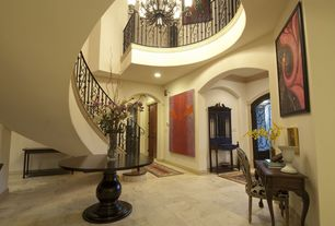 Mediterranean Entryway with Crown molding, French doors, limestone floors, Upscale Rails & Stairs Custom Iron Balusters