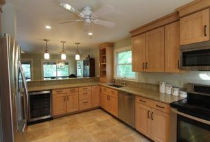 Modern Kitchen with gas range, dishwasher, L-shaped, Wine refrigerator, built-in microwave, picture window, stone tile floors