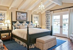 Cottage Guest Bedroom with Casement, High ceiling, Exposed beam, picture window, Carpet, Chandelier, Laminate floors