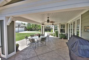 Traditional Patio with exterior stone floors, French doors, Fence, Wrap around porch, Trellis