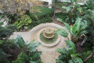 Mediterranean Landscape/Yard with exterior tile floors, Fountain