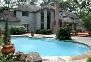 Traditional Swimming Pool with exterior stone floors, specialty window, French doors, picture window, Pool with hot tub