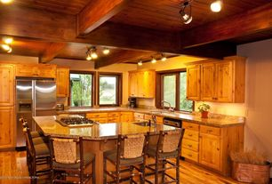 Craftsman Kitchen with can lights, Simple granite counters, Raised panel, Breakfast bar, Casement, Hardwood floors, L-shaped