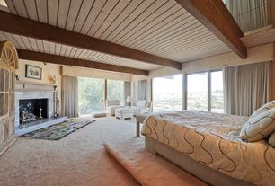 Traditional Guest Bedroom with picture window, Fireplace, sliding glass door, insert fireplace, interior wallpaper, Carpet