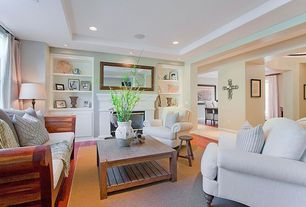 Traditional Living Room with High ceiling, Laminate floors, Cement fireplace, can lights, Carpet, Fireplace