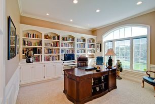 Traditional Home Office with Carpet, Crown molding, Arched window, Built-in bookshelf, Wainscotting