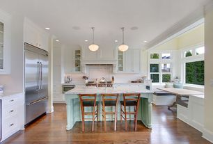Traditional Kitchen with full backsplash, double-hung window, Wolfe - 6 burner + griddle, double oven, Glass panel, Paint 1