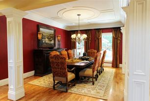 Traditional Dining Room with Hardwood floors, Chandelier, Crown molding, Columns, Box ceiling