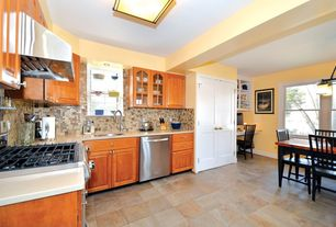 Country Kitchen with Wall Hood, stone tile floors, L-shaped, Glass panel, Limestone counters, Flush, flush light, dishwasher