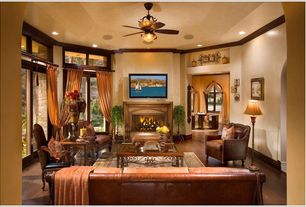 Mediterranean Living Room with Fireplace, Hardwood floors, can lights, French doors, Standard height, Ceiling fan, Casement