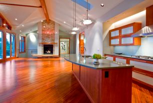 Contemporary Great Room with Hardwood floors, Transom window, Exposed beam, flush light, stone fireplace, French doors