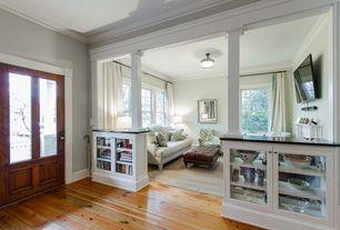 Traditional Entryway with Crown molding, Glass panel door, Built-in bookshelf, Standard height, Hardwood floors, Columns