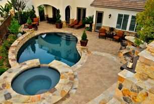 Mediterranean Swimming Pool with exterior stone floors, Pool with hot tub, French doors, Outdoor seating area, Fence