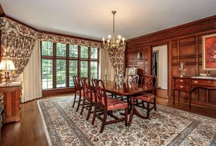 Traditional Dining Room with Casement, Hardwood floors, Standard height, Chandelier, Crown molding